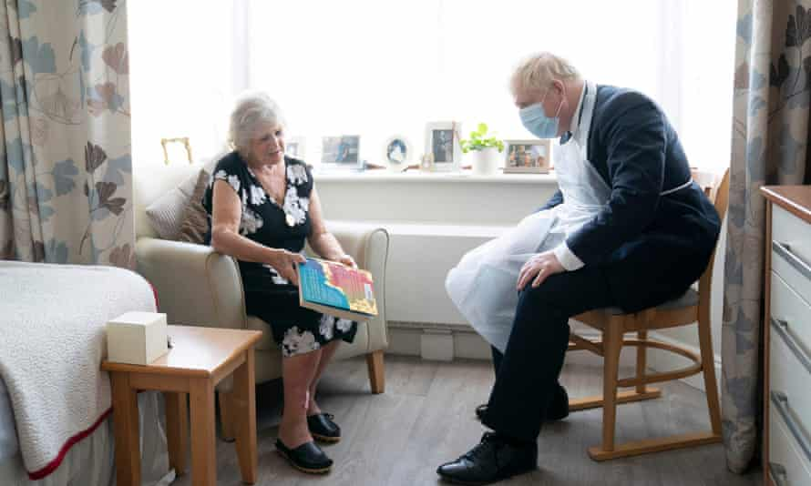 Boris Johnson talks to Kathleen, a resident at Westport care home in east London.