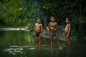 Playing with fire...Young children play together in the local river