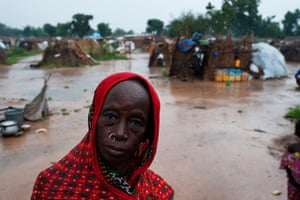 A woman in the rain in the Kuraketa IDP camp in Damaturu, which has no current links to the Nigerian Government nor to any NGO.