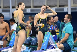 Cate Campbell, left, and Bronte Campbell with coach Simon Cusak during the team's first training session at the Rio Olympic Games aquatics centre in Rio de Janeiro.