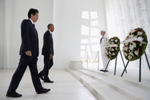 President Barack Obama and Japanese prime minister Shinzo Abe participate in a wreath-laying ceremony at the USS Arizona Memorial