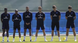 Members of the England football team team fall silent near St Petersburg in Russia