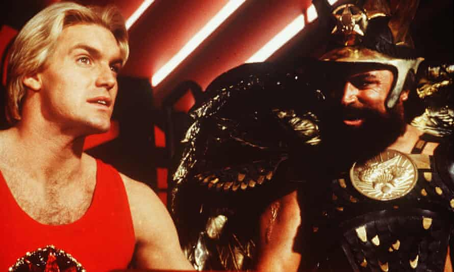 'He's not supposed to be the sharpest knife in the drawer' ... Sam J Jones as Flash, left, with Brian Blessed as Prince Vultan.