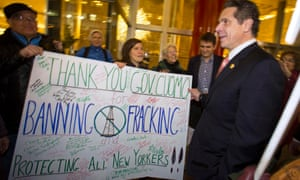 New York Governor Andrew Cuomo greets fracking protesters