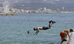 Children swim in Marseille