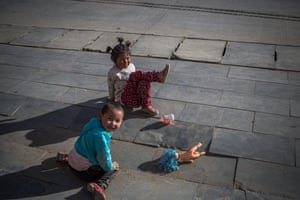 Children play in the street near the Labrang Monastery, in Xiahe, an ethnically-Tibetan town in Gansu province, China