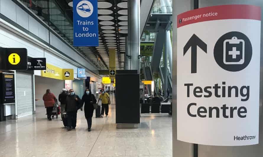 Passengers arrive at Heathrow airport on Friday