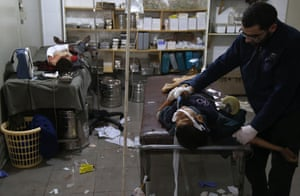 Wounded Syrians receive treatment in a makeshift clinic in eastern Ghouta
