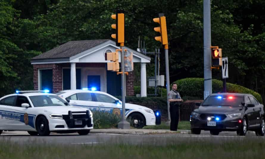 Police cars are seen after an FBI agent opened fire on an armed man outside the CIA headquarters gate in Langley, Virginia.