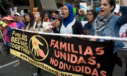 Marchers in San Diego protest against the separation of families detained at the US-Mexico border.