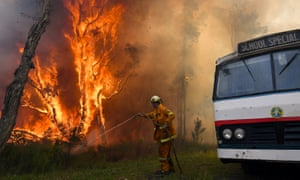 A firefighter tackles a bushfire in Salt Ash, north of Newcastle