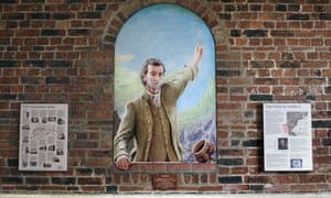 Mural painting of Tom Paine by Julian Bell, on a wall in Market Passage, Lewes.