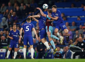 Burnley's Ashley Barnes in action with Chelsea's Andreas Christensen.