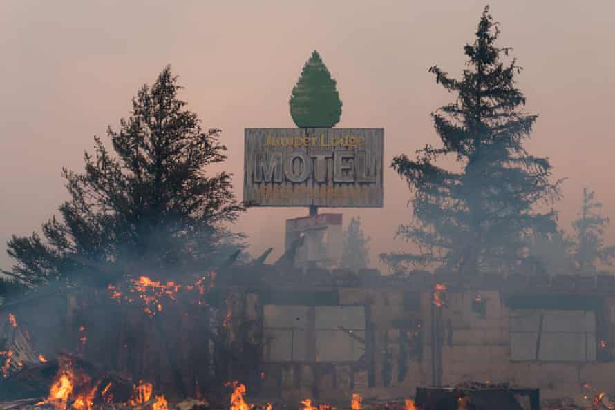 A motel burns in a wildfire near the town of Weed, California, on 29 June.