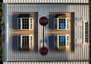 Tarboro, USA: A building and street signs are reflected in flood waters