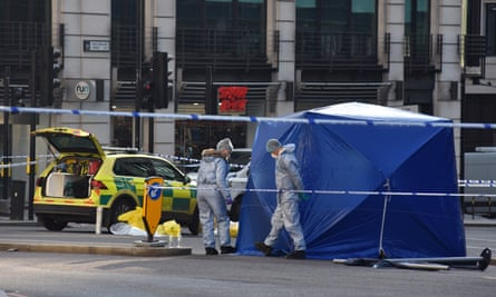 Forensic officers investigate the scene of the fatal stabbing attack.