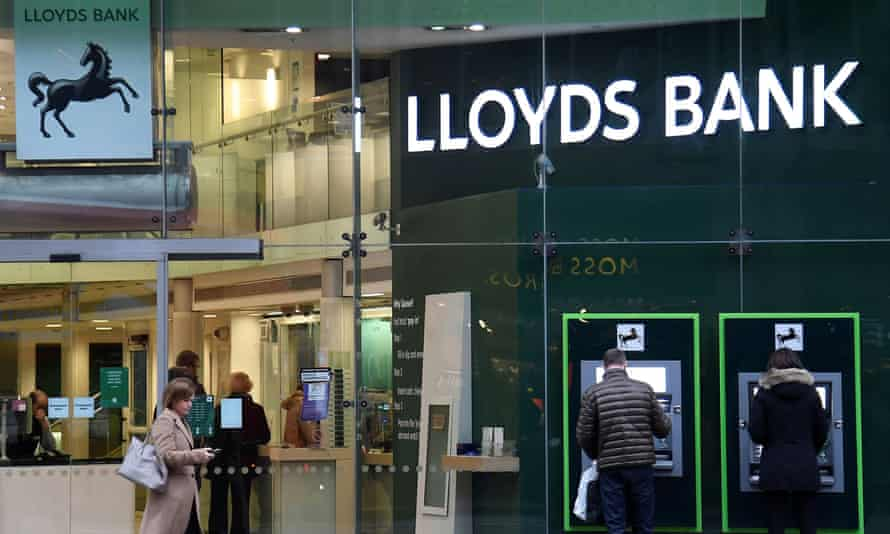 Customers at a branch of Lloyds bank in London.