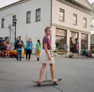 A young woman on a skateboard in the Appalachia, by photographer Meg Wilson.
