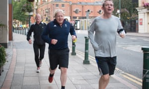 Boris Johnson (centre) takes an early morning run at the conference.
