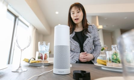 A woman interacts with Amazon Echo Plus.