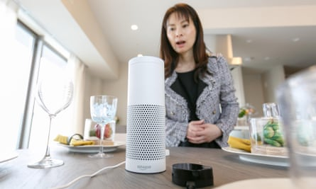 A woman interacts with Amazon Echo Plus