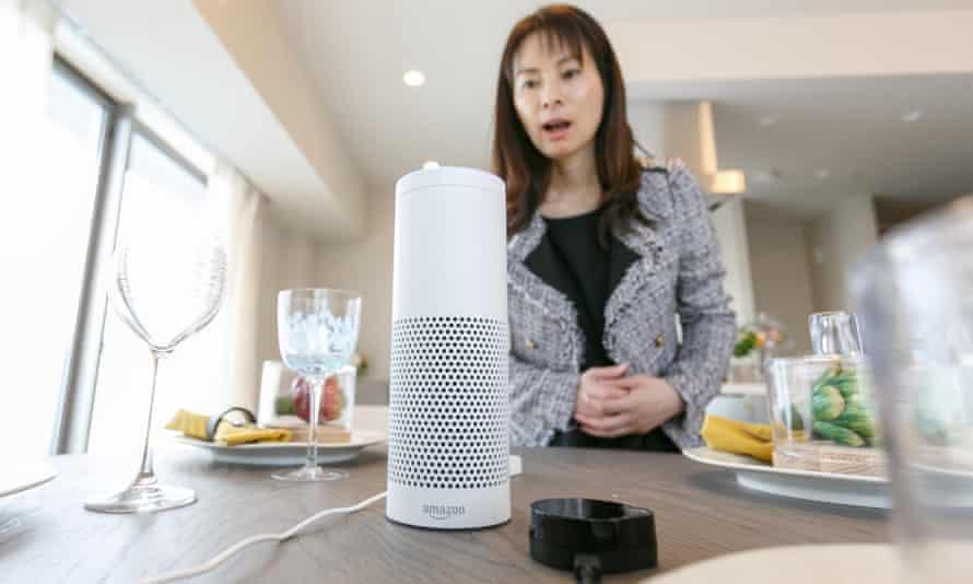 woman speaking to an Amazon Echo.