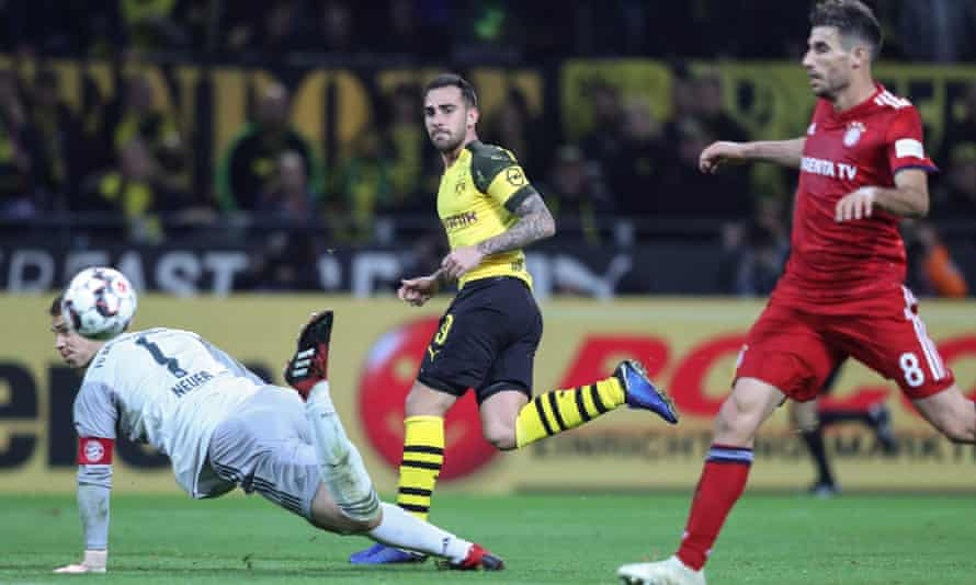 Paco Alcacer (centre) dinks the ball over Manuel Neuer to win the match.
