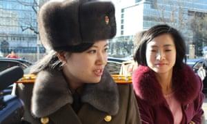 Hyon Song-wol, left, leader of the Moranbong band, arrives at a Beijing hotel on 11 December. North korea