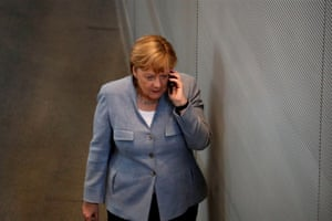 Berlin, Germany The chancellor, Angela Merkel, takes a call at the lower house of parliament during a budget session