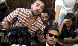Baher Mohammed, left, and Mohammed Fahmy in the Cairo court where they were sentenced on 29 August.<br>