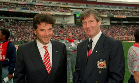 David Dein, left, who made £75m selling his Arsenal shares, at a 1993 friendly with then Manchester United chairman Martin Edwards, who collected £94m from his directorships and sale of club shares