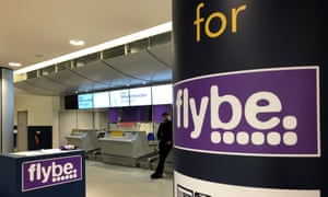 A man standing by a check-in desk at Manchester airport after Flybe, Europe's biggest regional airline, collapsed into administration.