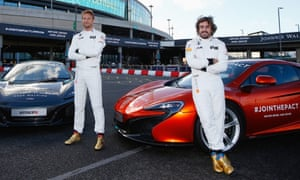 Jenson Button, left, says he enjoys working alongside Fernando Alonso, right, at McLaren. 'Because of our experience they listen to us and we help develop the car,' Button says.