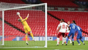 But he's thwarted by the great reactions of Denmark's keeper Kasper Schmeichel .