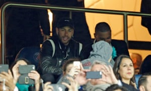 Neymar watches PSG's game against Manchester United from the stands. The Brazilian was unimpressed by the penalty decision in added-on time.