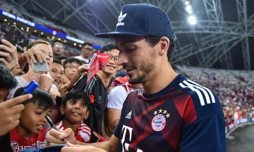 Mats Hummels signs autographs for fans during Bayern Munich's pre-season tour to Singapore in July