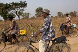 Three farmers on their bikes in central Angola, 2007