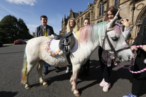 Four freshers at Glasgow university looking at a 'unicorn'