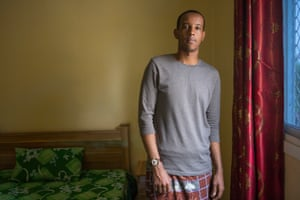 Jabril, 20, From London, in his bedroom in the house where he is staying during a teaching placement over the summer months.