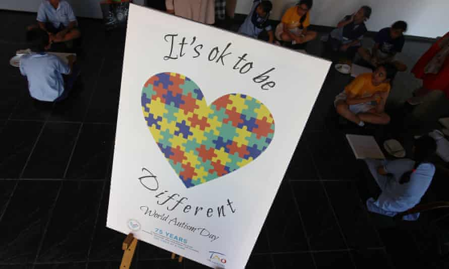 Jigsaw pieces come together to form a heart, with the theme 'It's OK to be different', on a poster for World Autism Day