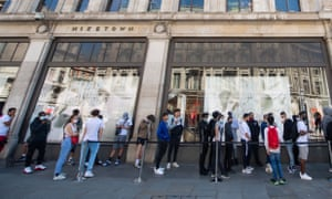 Queues outside Nike Town on Oxford Circus, London, as non-essential shops in England open their doors to customers for the first time since lockdown began.