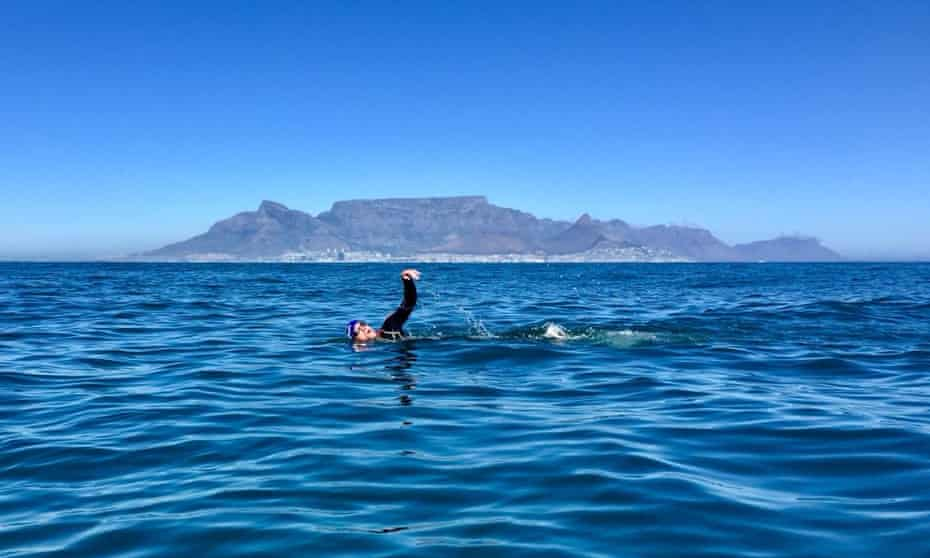 In reach of the city … writer Graham Little swimming from Robben Island, with Table Mountain in the background