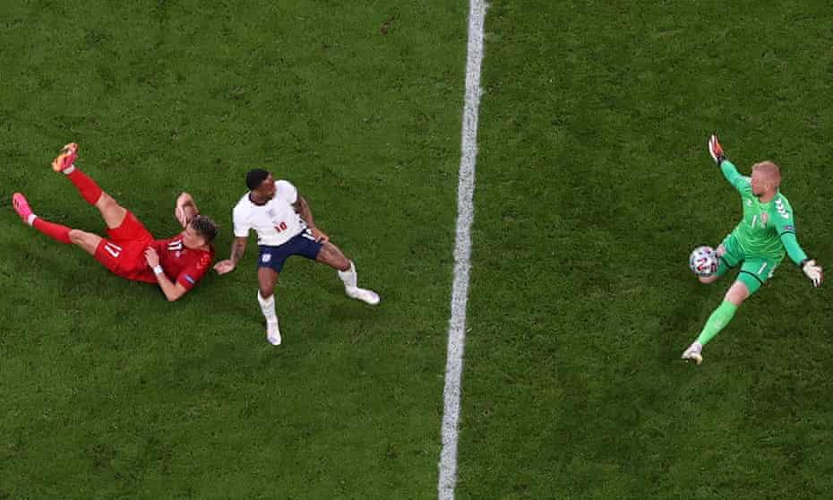 Raheem Sterling's point blank shot is saved by Denmark keeper Kasper Schmeichel.