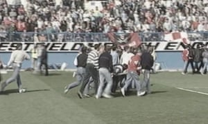 Footage released by the Hillsborough coroner shows supporters trying to help the injured.