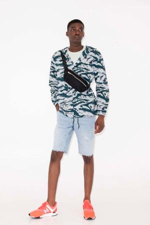 grey, blue, green patterned jacket, black bumbag, white t-shirt, Weekday, faded denim cut-off shorts All Saints, orange trainers New Balance