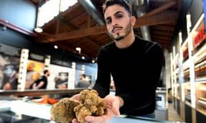 A vendor presents truffles.