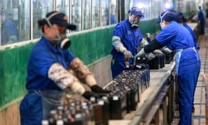 This photo taken on 30 March, 2020 shows employees working on a battery production line at a factory in Huaibei in China's eastern Anhui province.