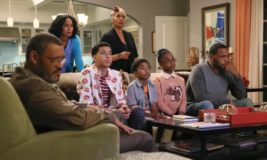 The family in ABC's comedy Black-ish, including Dre Johnson, right.