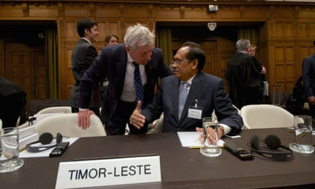 Timor-Leste's then foreign affairs minister Jose Luis Gutierrez (right) speaks with Australian lawyer Bernard Collaery at The Hague in 2014, when Timor-Leste took action against Australia in the international court of justice.
