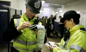 two British Transport police officers at a London Tube station